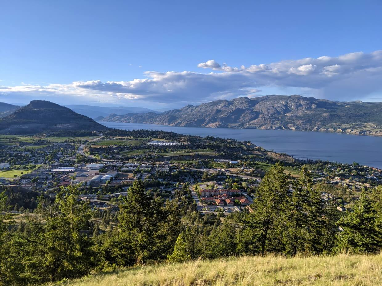 View from Friendly Giant Trail on Giant's Head Mountain, lookign own to the town of Summerland, with Rattlesnake Mountain on left, Okanagan Lake on the right with the rugged peaks of Okanagan Mountain Park in the background