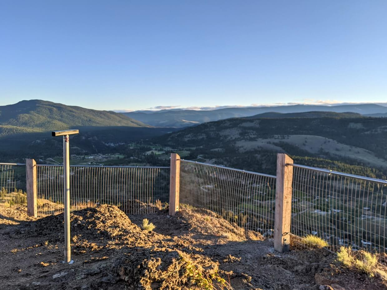View of lookout area at Giant's Head Mountain Summit, with fencing in front of valley views