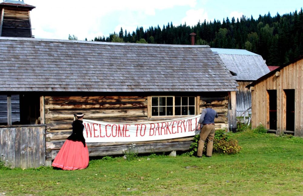 Welcome to Barkerville sign being attached to historic wooden building