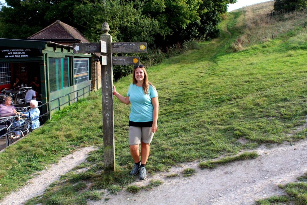 Gemma at the final signpost of the South Downs Way long distance path