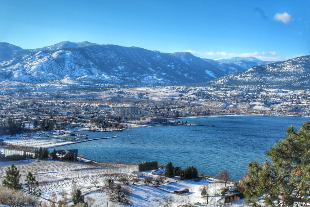 City of Penticton surrounded by snowy mountains and lake