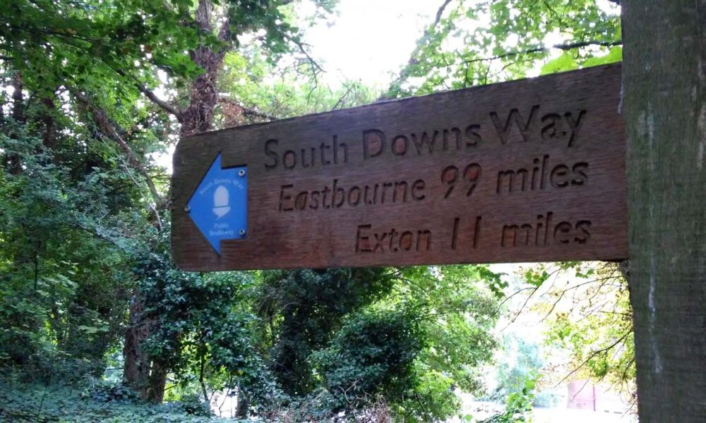 First signpost of the South Downs Way, showing 99 miles to Eastbourne