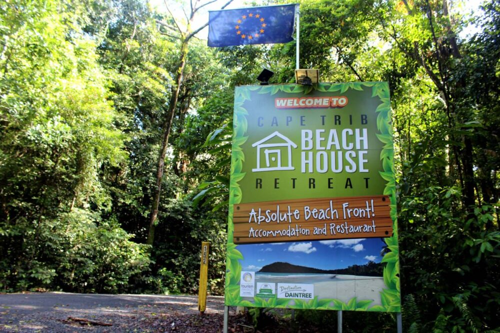 cape trib beach house retreat sign