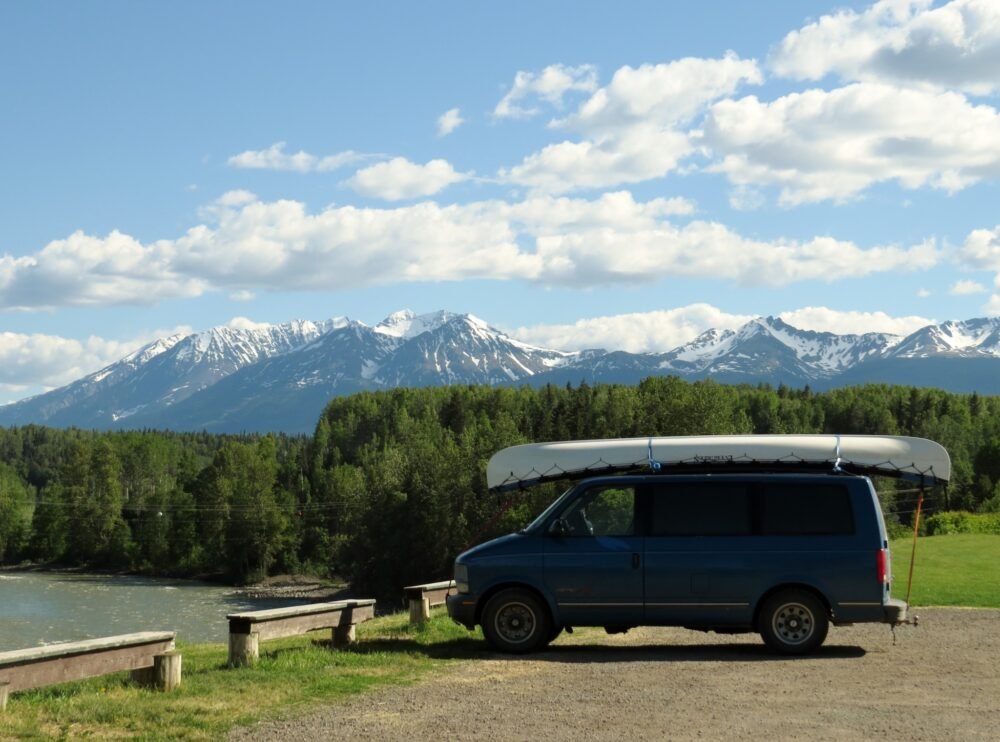 Blue Astro Van with Northern British Columbia mountains in background