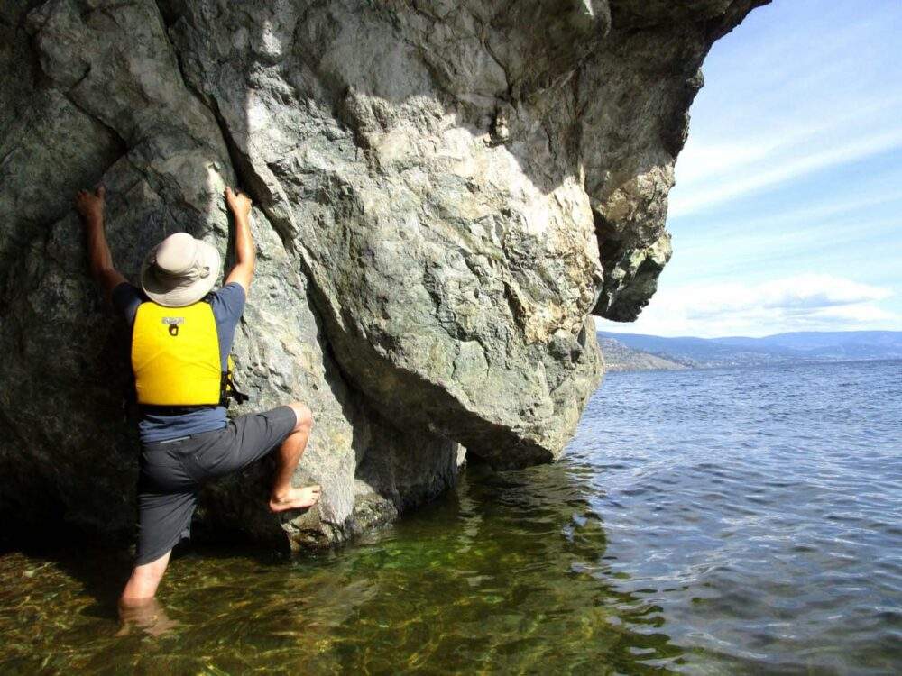 Jr Climbing cliffs at the edge of Okanagan Mountain Park