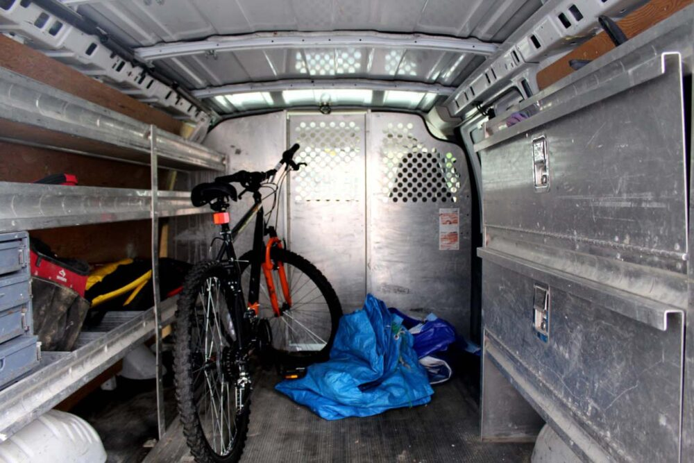 GMC Savana van interior with contractor shelving