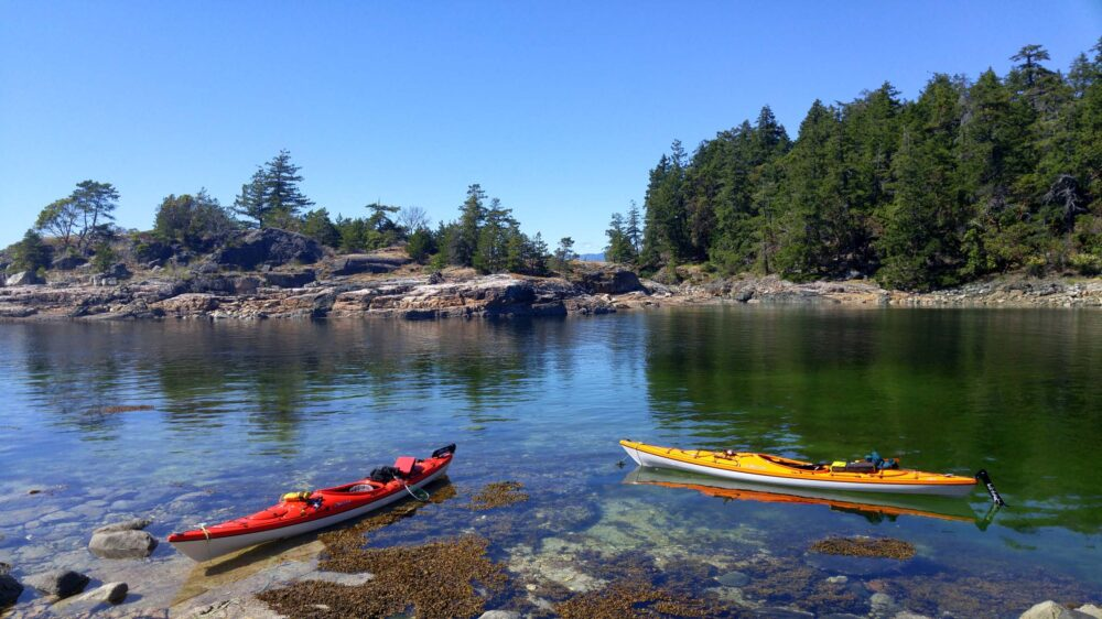 Red and orange Kayak at Copeland Island, Desolation sound