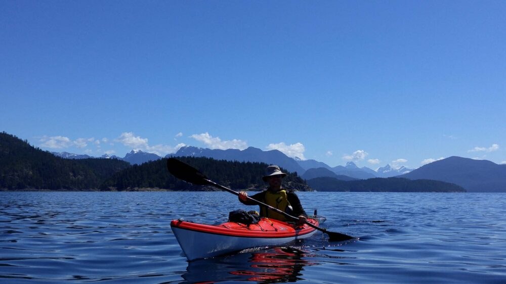 Paddling Desolation Sound with mountains in background