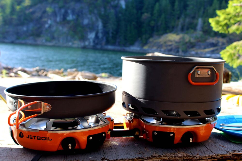 Two burner camping stove in front of ocean view
