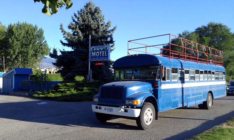 The distinctive blue Coyote Cruises school bus