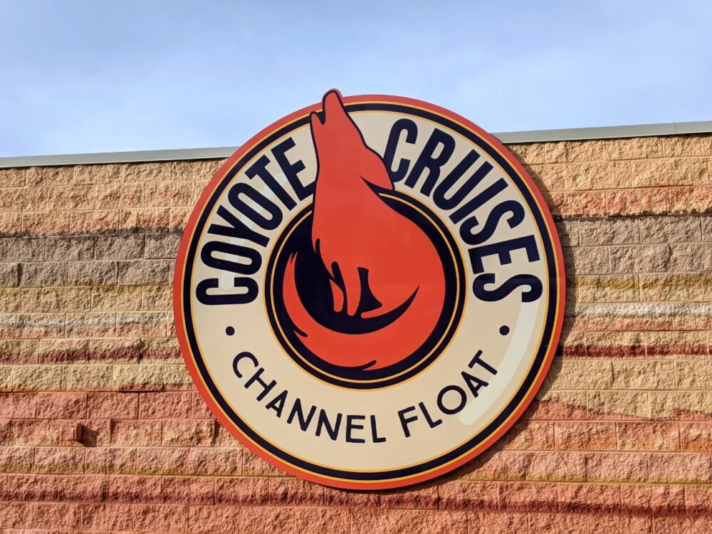 Sandy coloured building with coyote logo - Coyote Cruises