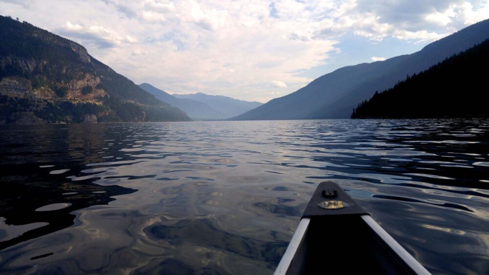 The view from the canoe on Slocan Lake, looking towards mountains