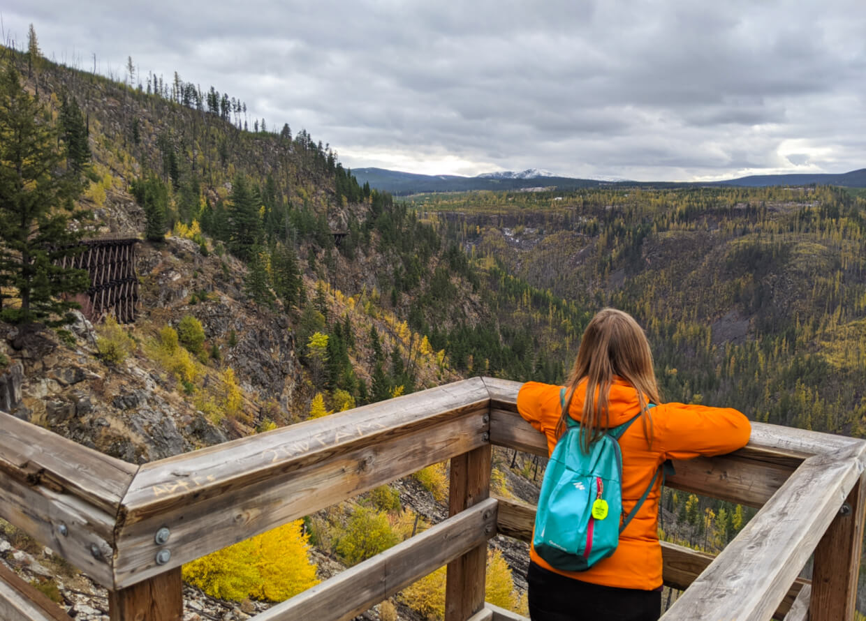 Gemma standing on viewing platform on trestle bridge in Myra Canyon