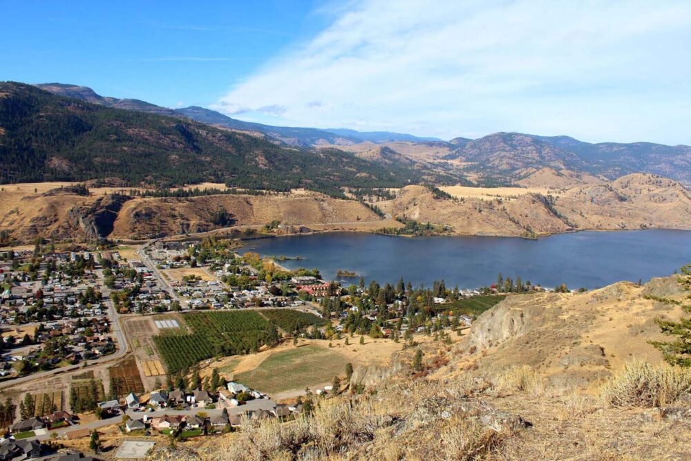 Sunburnt valley hills with blue Skaha Lake and Okanagan Falls township