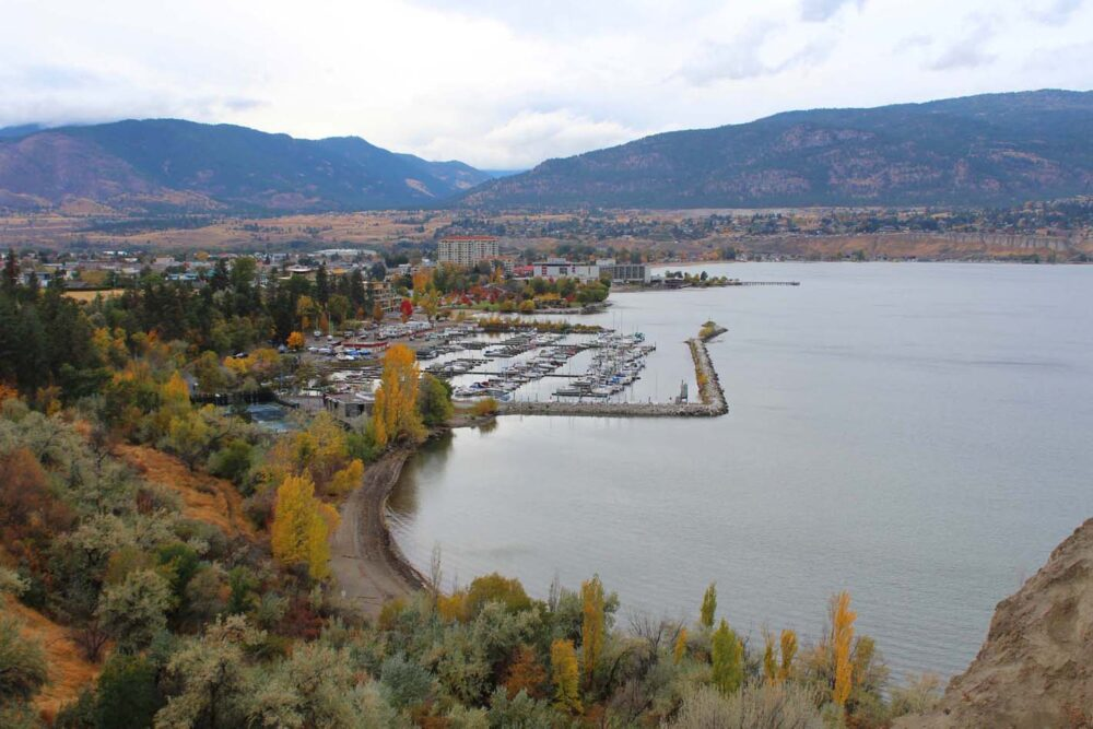 Penticton's marina next to Okanagan lake, highlighted by autumn trees