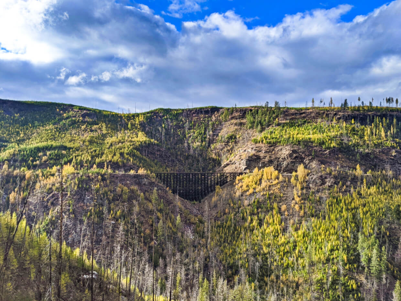 View across Myra Canyon of wooden railway trestle