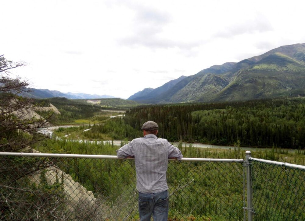 JR with the Northern Rocky Mountains on the Alaska Highway, British Columbia