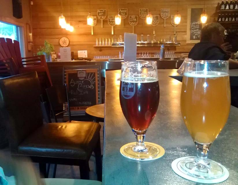 Two beer glasses on pub bar in Highway 97 brewery