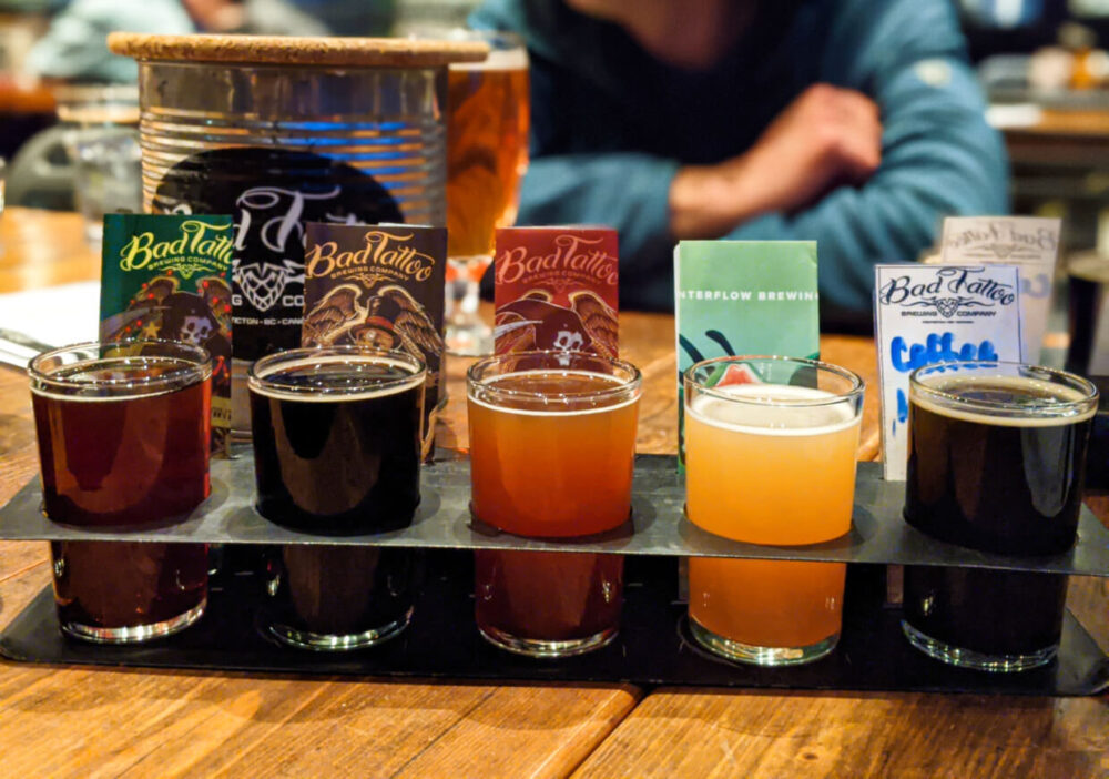 Close up of beer flight at Bad Tattoo, with five differently coloured beers in holder