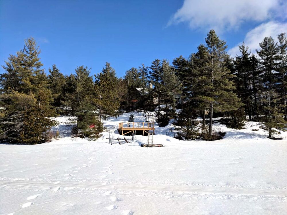 10 Ways to Explore Canada's Winter Wonderland - view of cabin from lake