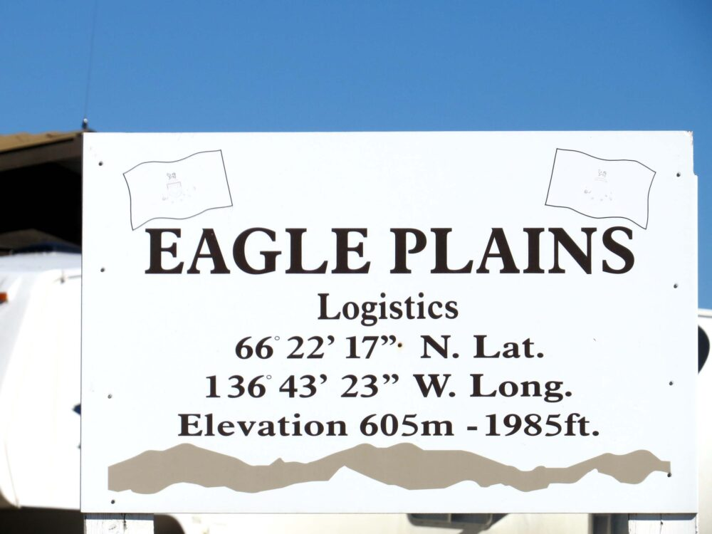 Eagle Plains sign with latitude and longitude on the Dempster Highway