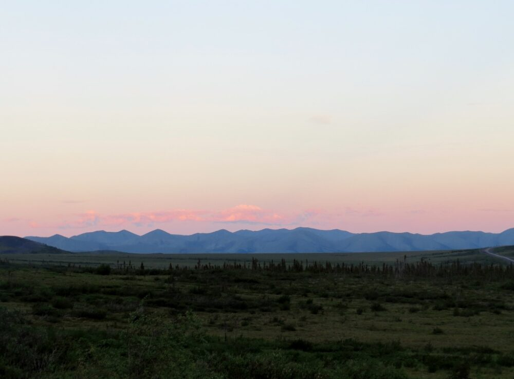 Mountain range with pink sunset behind