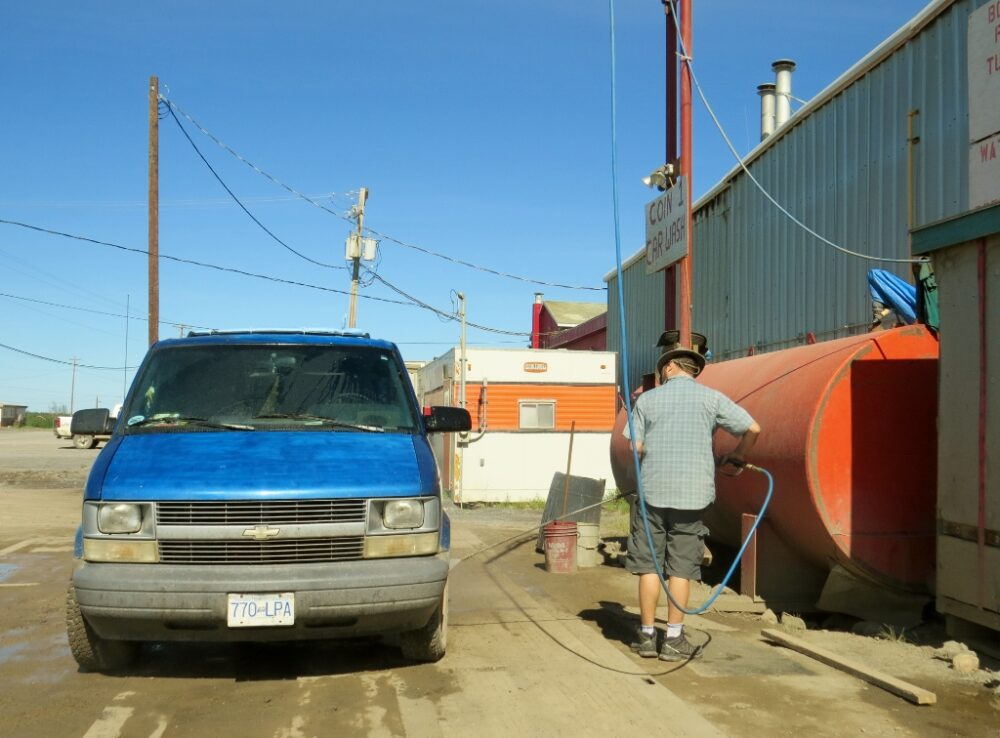 JR with power hose, cleaning van