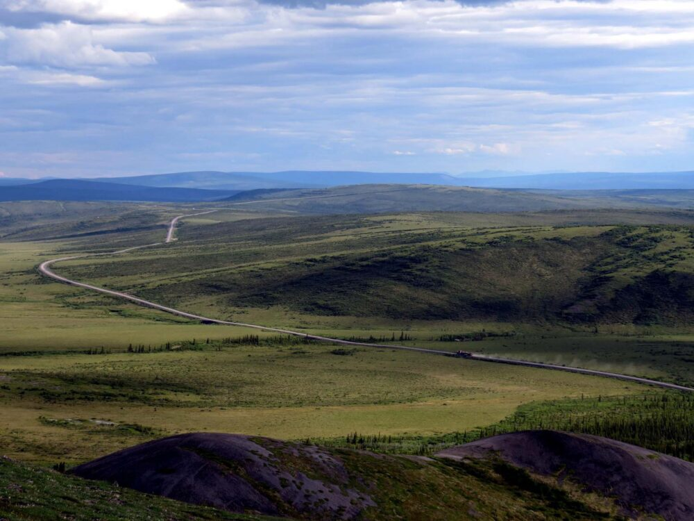 Elevated views of the Dempster Highway leading into the distance