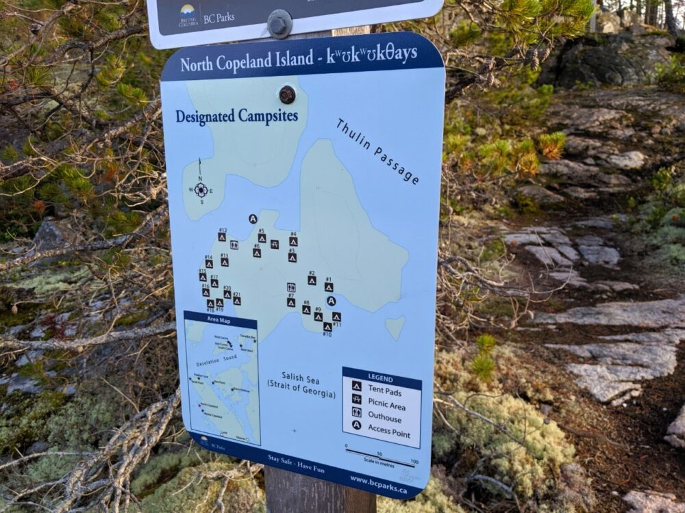 BC Parks sign with map of island with tent pads