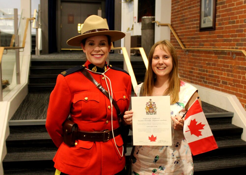 Gemma with mountie at Citizenship Oath Ceremony