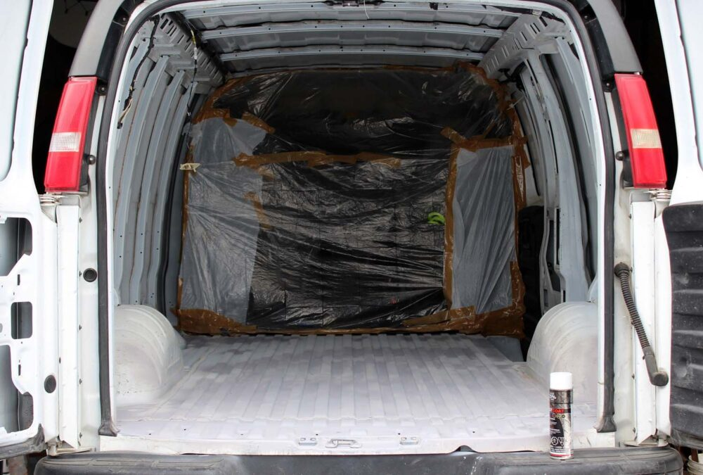 empty painted GMC Savana van conversion