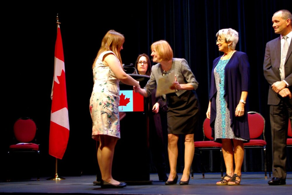 Gemma at Canadian Citizenship Oath Ceremony receiving Canadian citizenship certificate