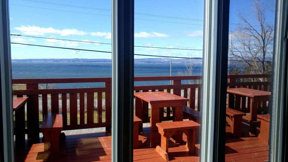 Ocean views from Auberge Internationale Forillon dining area, alternative to gaspesie camping