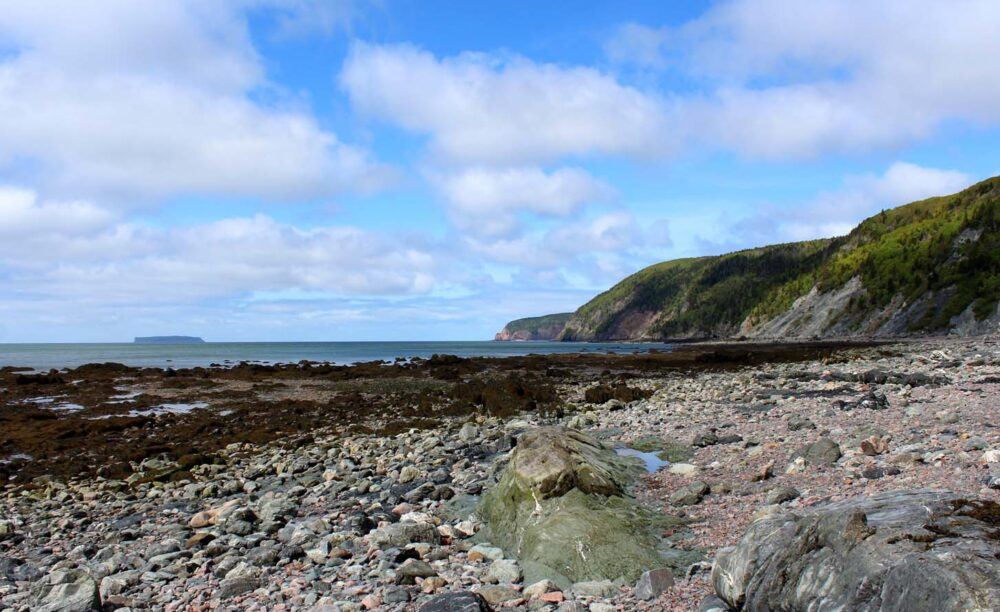 Looking across a rocky beach on the Cape Chignecto Coastal Trail
