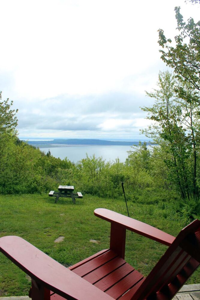 Looking out from behind a deck chair towards the ocean from the Arch Gulch cabin on the Cape Chignecto Coastal Trail