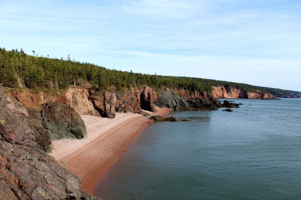 A pink sandy beach on the Cape Chignecto Coastal Trail