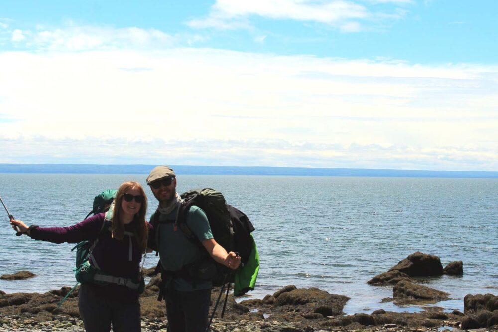 JR and Gemma standing together on Red Rocks beach, having just finished the 51km Cape Chignecto Coastal Trail