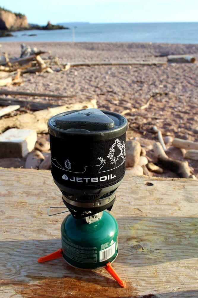 Jetboil stove on wooden driftwood table on Seal Cove beach, Cape Chignecto Coastal Trail