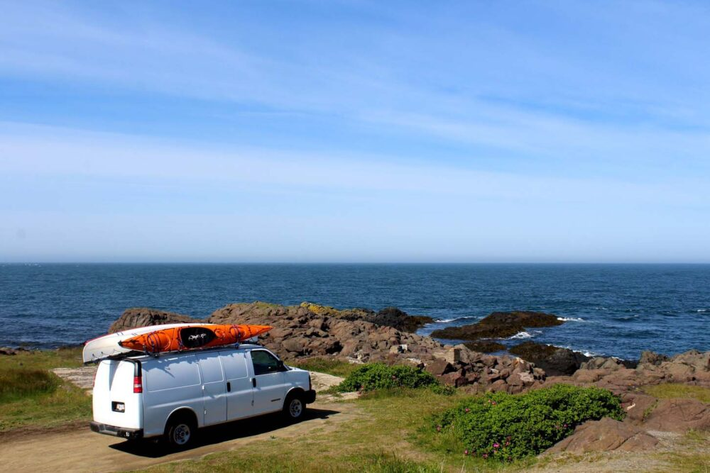 White van on rocky coastline, Nova Scotia
