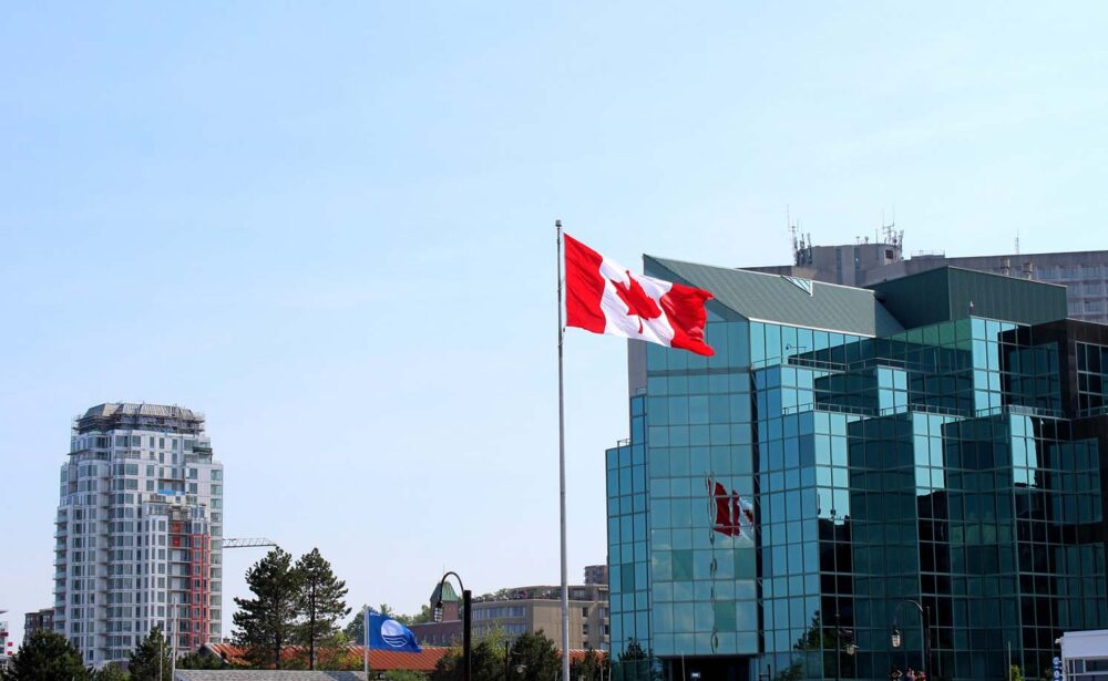 Skyscrapers in downtown Halifax with Canadian flag in foreground