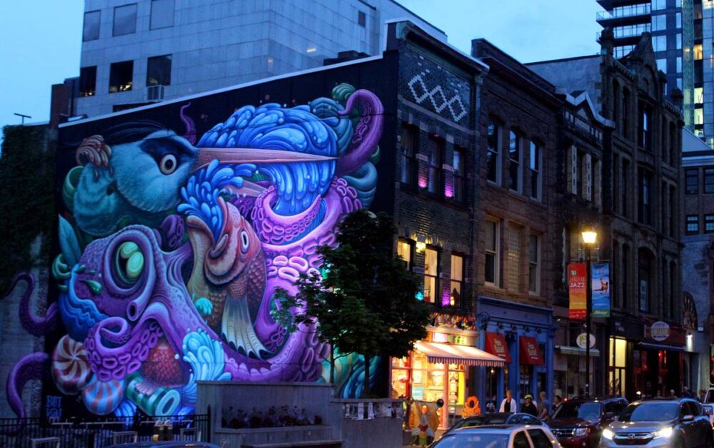 ocean themed street art on the side of period buildings in Halifax
