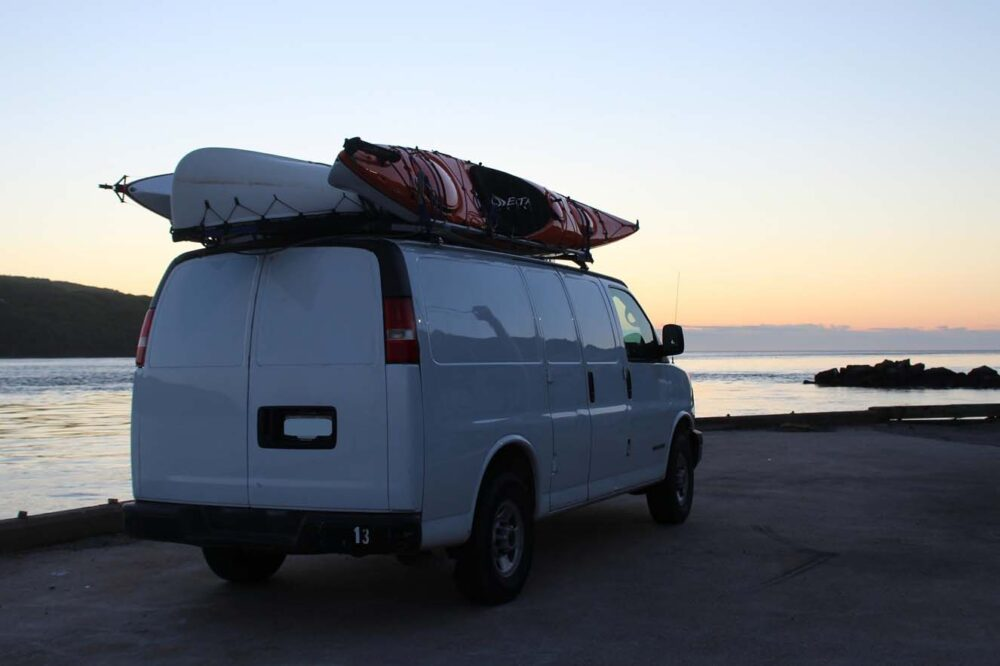 sunset view of gmc savana conversion van in nova scotia