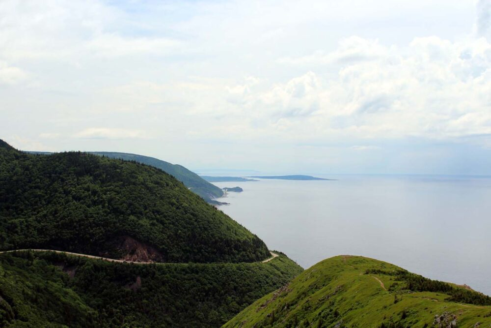 View of a winding road above ocean in Cape Breton