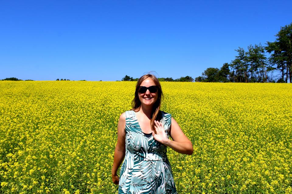 gemma in front of canola fields pei canada