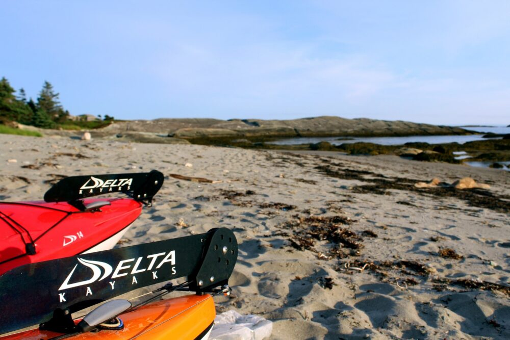 Delta kayak rudders on sandy beach