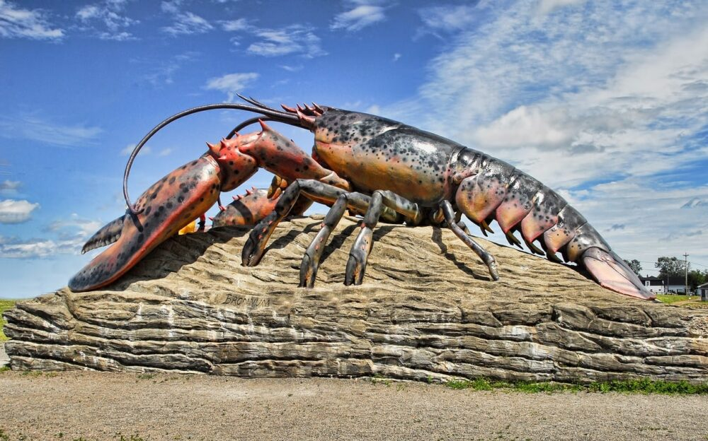 Giant lobster statue perched on rock in Shediac