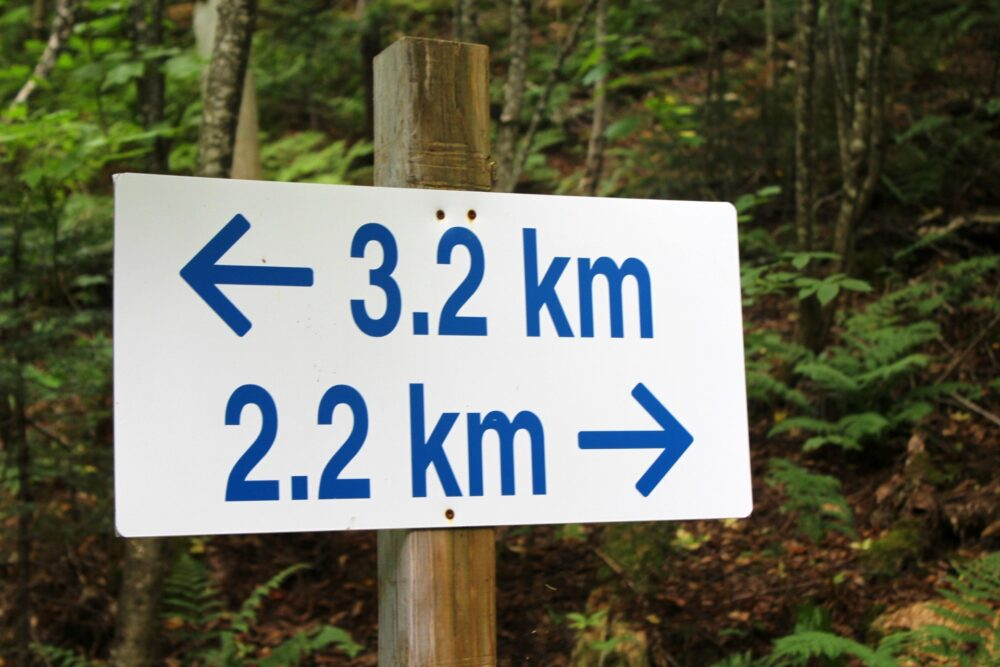 Trail sign with 3.2km one way and 2.2km the other way
