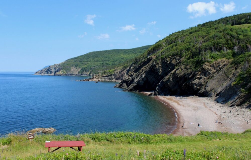 Campsite views from Meat Cove Campground of ocean, beach and other camping spots