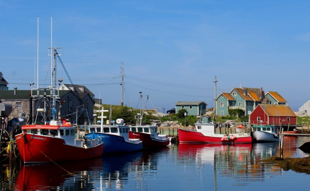 Colourful boats and cottages in Nova Scotia fishing village