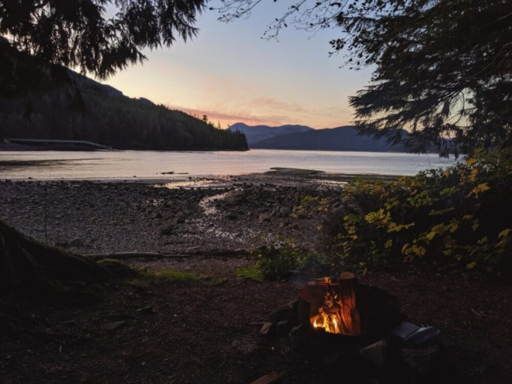 Campfire scene looking out to ocean on Vancouver Island
